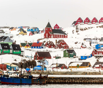 Colorful houses and church on the hill Sisimiut town view from seaside Greenland
