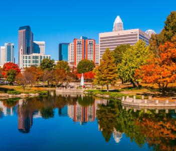 Charlotte city skyline from Marshll park autumn season with blue sky