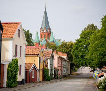 Street of houses in Västervik and church top in Sweden