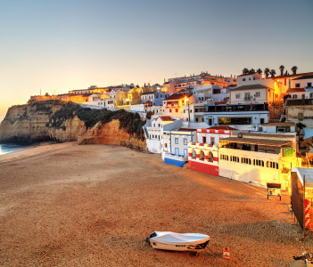 A panorama of Carvoeiro at the dusk in Albufeira, Algarve region, Portugal, Europe