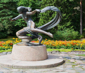 A bronze sculpture displaying a young girl named Egle in  Palanga Botanical Garden Lithunia