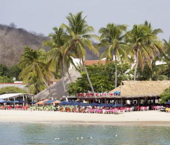 Beach of Bahia de Santa Cruz resort town Huatulco Mexico