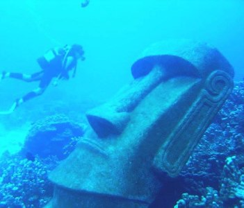 diving close to moai in deep haga roa bay