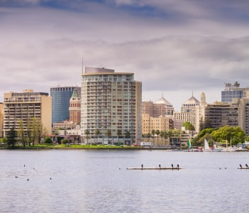 Downtown Oakland as seen from across Lake Merritt on a cloudy spring day, San Francisco bay area, California