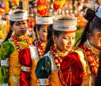 Young girls wear traditional colourful costumes with large necklaces during Shad Suk Mynsiem Festival in Shillong Meghalaya