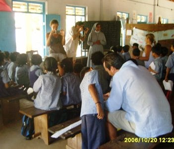 A class room visited by visitors.