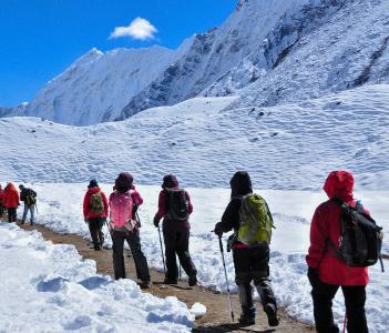 Trekker walking from Chukhung to Island Peak base camp in Nepal