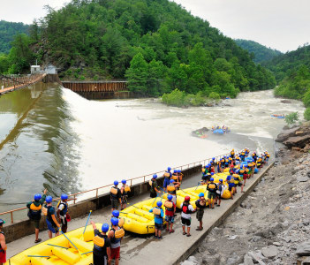 Youth wait in line before launching their rafts for whitewater rafting along the Ocoee River in USA