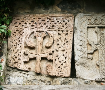 Ancient cross-stones or khachkars in Vanadzor city Armenia. Khachkars are carved memorial stele covered with rosettes and other patterns unique art of Medieval Christian Armenia.There are several thousand cross-stones in Armenia each distinguished