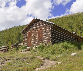 Log cabin in mining town in western USA