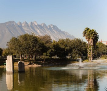 Parque Ninos Heroes lake landscape with mountains through the haze in the background
