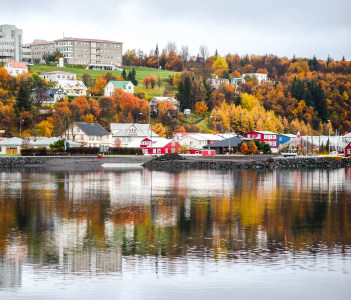 Akureyri in autumn Northern city of Iceland reflecting on water