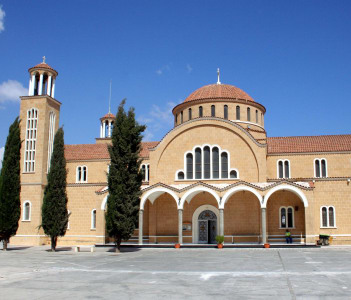 Exterior facade of traditional Cypriot church and bell tower Larnaca