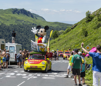 The Car of the Journal de Mickey during the passing of the Publicity Caravan on the road to Pas de Pyerol (Puy Mary) in Cantalin the Central Massif