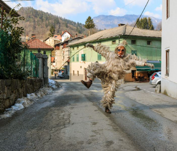 Slovene traditional carnival mask Laufar running and jumping on the streets of Cerkno in Slovenia