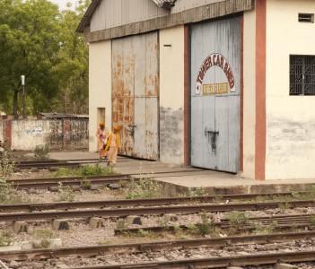 Two Sadhus walking over train tracks, Jeypore, Orissa, India