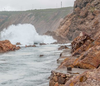 The Point tidal swimming pool in Mosselbay South Africa on a stormy day