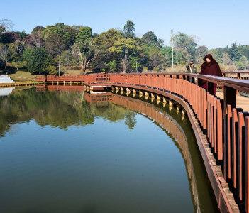 Walking on a Wooden Bridge over Kandawgyi Lake