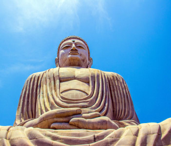 Giant Buddha in Bodhgaya Bihar under blue sky