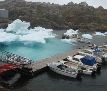 Large iceberg strands in Tasiilaq harbor