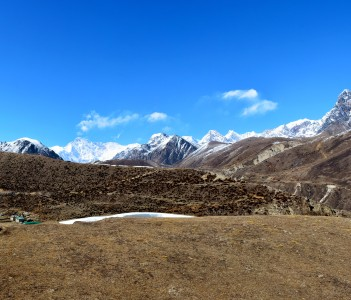 Panoramic view of the Cho-Oyu mountain ridge and Machhermo village. Himalayan mountains, Nepal
