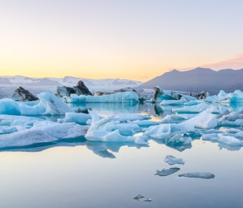 Icebergs in Jokulsarlon glacial lake at sunset in Iceland