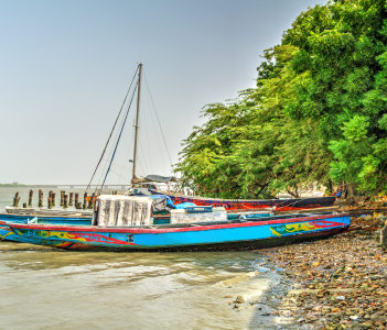 African boat on the river bank Ziguinchor Senegal