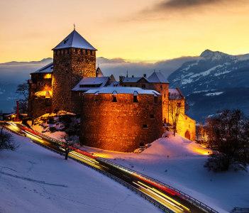 Illuminated castle of Vaduz at sunset
