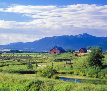 A farm near Joseph, Oregon with the Wallowa Mountains in the background, USA
