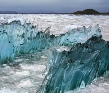 Dense green amorphus glacial ice floating in Laguna San Rafael South America