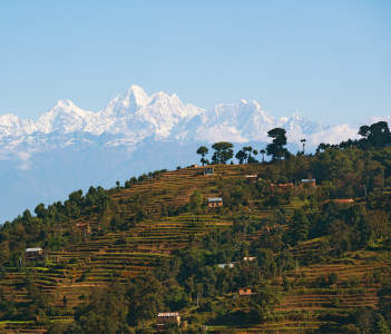 View of Himalayan village with mountain backdrop