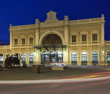 The Central Station in the city of Cartagena illuminated at night, Region of Murcia, Spain