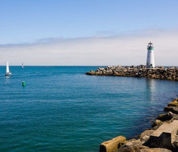 Lighthouse and sail boats in Santa Cruz