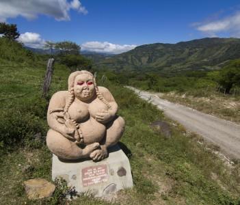 Stone sculpture representing a fat woman placed on - la ruta del cafe - (the coffee route) in the mountains surrounding Esteli, Nicaragua