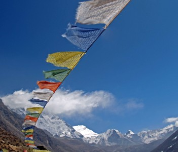 Prayer flags with Island Peak and Makalu