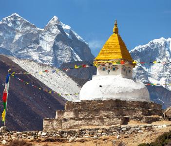 Stupa near Dingboche village with prayer flags and mounts Kangtega and Thamserku, Khumbu valley, Nepal