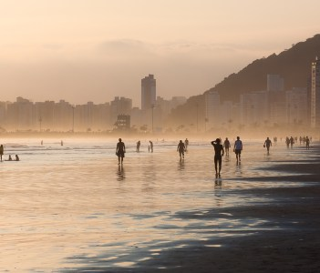 Walking on the beach at the sunset, Santos, Brazil
