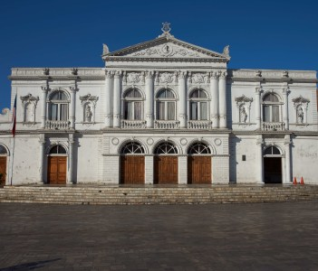 White classical style theatre in Plaza Arturo Prat in the old quarter of Iquique on the Pacific coast of northern Chile
