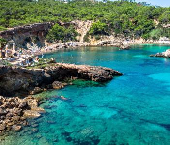 Ibiza Punta de Xarraca turquoise beach paradise in Balearic Islands.