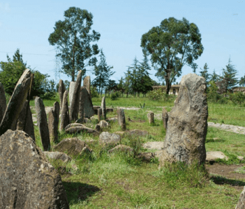 It is best known for its archaeological site, a UNESCO World Heritage Site remarkable for its large stone pillars, many of which bear some form of decoration.