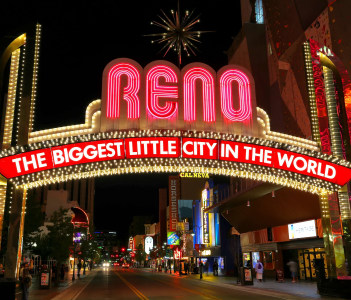 """""""The Biggest Little City in the World"""" sign over Virginia street at nigh"""