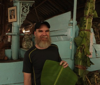Greg posing with a banana leaf