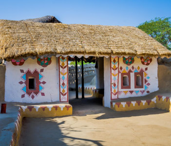 Exterior of a decorative entrance of house built with straw, mud and stone at village in Kutch, Gujarat, India