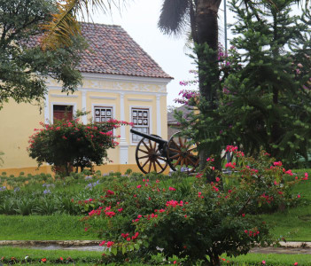 The ancient cannon among the flowers in the historic center the square Saint Blessed in the Museum of Arms, Lapa, Parana, Brazil