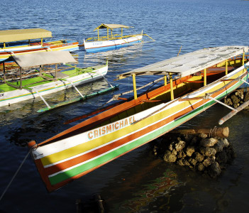 Colorful outrigger boat anchored at Lingayen Gulf