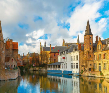 Scenic cityscape with a medieval fairytale town from the quay Rosary, Rozenhoedkaai in Bruges, Belgium