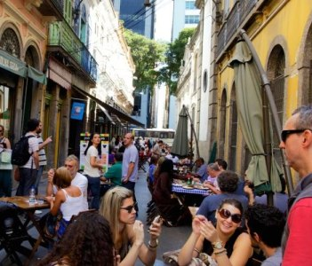 stone street in the historical and financial center of the city_Happy Hour after work