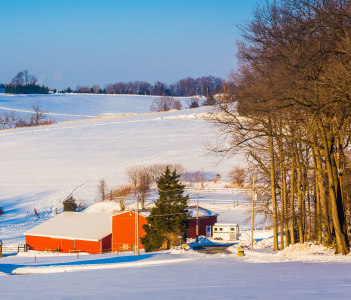 Winter view of farm fields and rolling hills in rural York County Pennsylvania.
