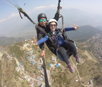 paragliding flight at pokhara a beautiful destination of nepal. fly like a bird with panaromic mountain range with fewa lake and pokhara city
