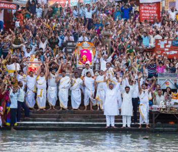 Hindu Pilgrims gather to offer prayers to the sacred river Ganga